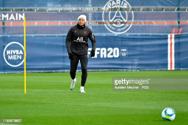 Kylian Mbappe warms up during a Paris SaintGermain training session at Ooredoo Center on December 14 2019 in Paris France