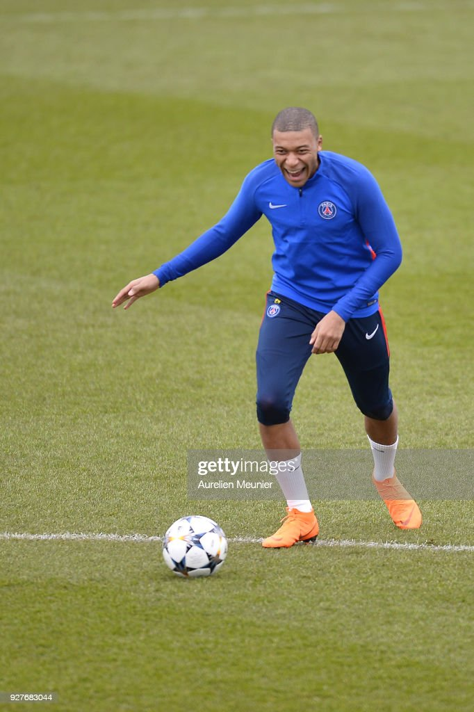 Kylian Mbappe warms up during a Paris Saint-Germain training session ahead of the Champion's League match against Real Madrid at Centre Ooredoo on March 5, 2018 in Paris, France.