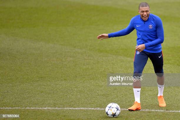 Kylian Mbappe warms up during a Paris SaintGermain training session ahead of the Champion's League match against Real Madrid at Centre Ooredoo on...
