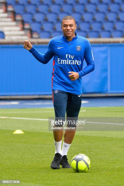 Kylian Mbappe warms up during a Paris SaintGermain training session at Parc des Princes on May 16 2018 in Paris France
