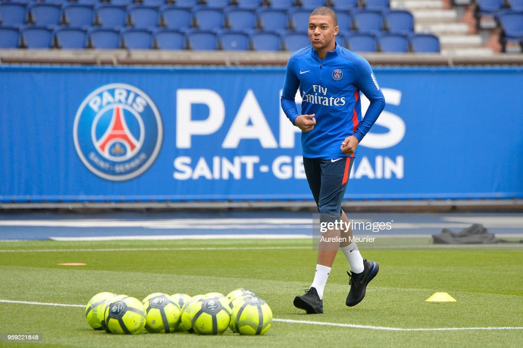 Kylian Mbappe warms up during a Paris Saint-Germain training session at Parc des Princes on May 16, 2018 in Paris, France.