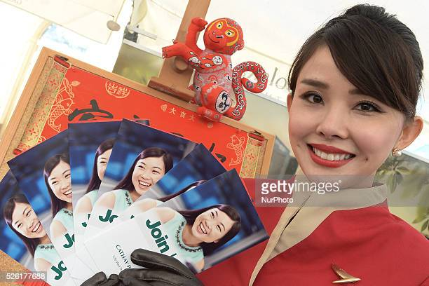 Kylie a member of the Cathey Pacicif airline staff is handing out promotional leaflets as one of the biggest airline in the world Hong Kong based...
