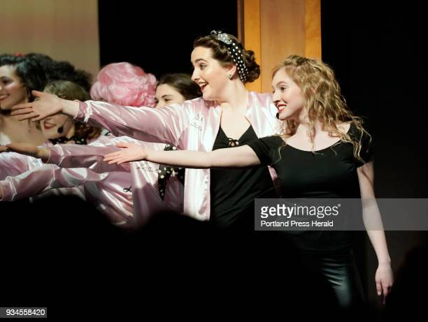 Kylie Belanger right and Delaney Bailey extend their arms with other cast members during the curtain call at the end of the opening night performance...