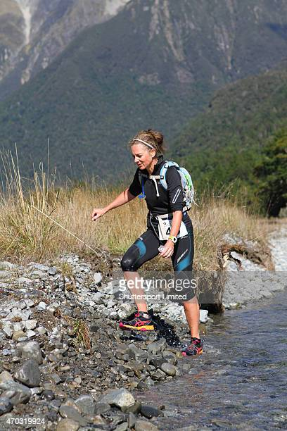 Kylie Broxton crosses the Travers River during the 2015 Alpine Lodge Loop The Lake trail run at Lake Rotoiti on April 18 2015 in Nelson New Zealand