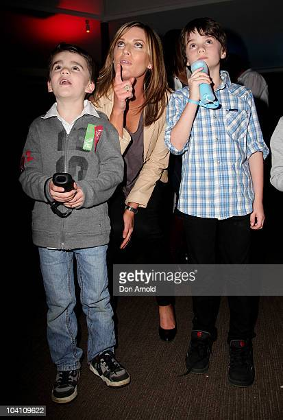 Kylie Gillies looks on as her sons Archie and Gus play the new Wii Party game during the offical Australian launch on September 15 2010 in Sydney...
