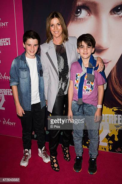 Kylie Gillies with sons Gus and Archie arrives at the Pitch Perfect 2 Sydney Premiere at George Street Cinemas on May 3 2015 in Sydney Australia