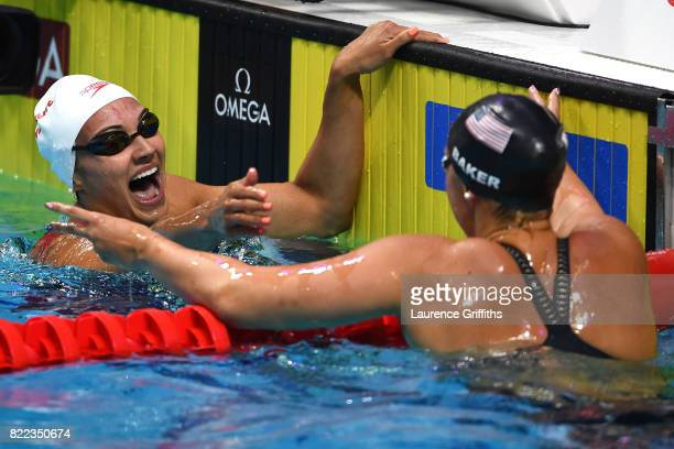 Kylie Jacqueline Masse of Canada is congratulated by silver medalist Kathleen Baker of the United States after winning the gold medal in a world...