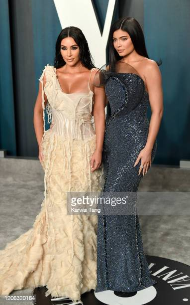 Kylie Jenner and Kim Kardashian attend the 2020 Vanity Fair Oscar Party hosted by Radhika Jones at Wallis Annenberg Center for the Performing Arts on...