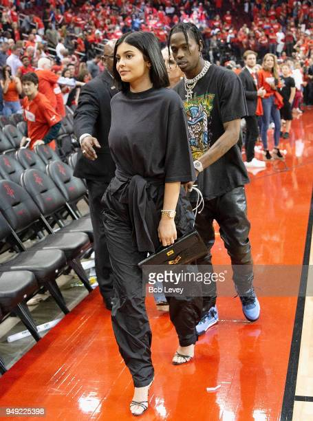 Kylie Jenner and Travis Scott leave after Game Two of the first round of the Western Conference playoffs at Toyota Center on April 18 2018 in Houston...