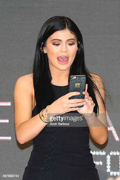 Kylie Jenner takes a selfie on her phone as Kendall Jenner and Kylie Jenner arrive at Chadstone Shopping Centre on November 18 2015 in Melbourne...