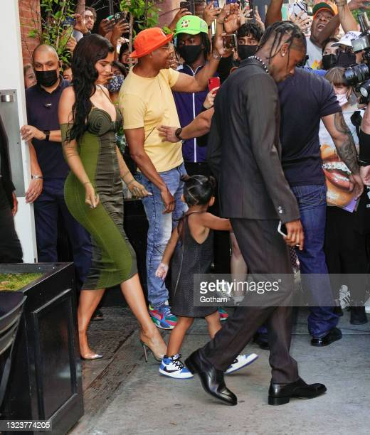 Kylie Jenner, Travis Scott and Stomi Webster are seen at Parson's Benefit at The Rooftop at Pier 17 on June 15, 2021 in New York City.
