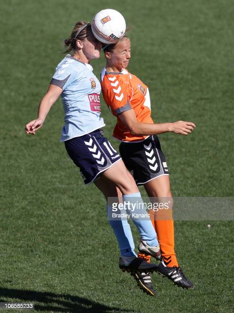 Kylie Ledbrook of Sydney and Aivi Luik of the Roar challenge for the ball during the round one WLeague match between the Brisbane Roar and Sydney FC...