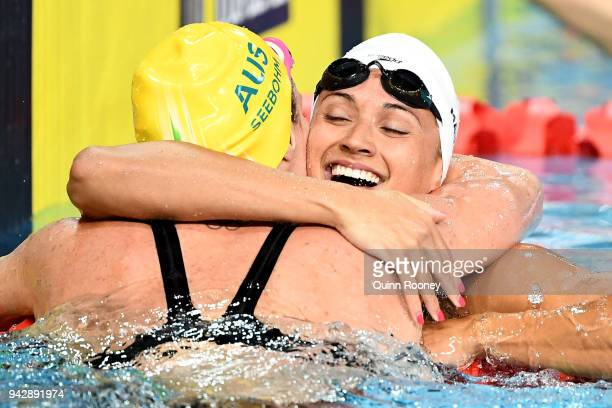 Kylie Masse of Canada and Emily Seebohm of Australia embrace following the Women's 100m Backstroke Final on day three of the Gold Coast 2018...