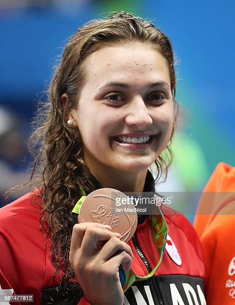 Kylie Masse of Canada celebrates third place in the Women's 100m Backstroke on Day 3 of the Rio 2016 Olympic Games at the Olympic Aquatics Stadium on...
