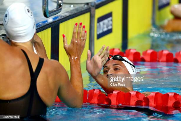 Kylie Masse of Canada celebrates with teammate Hilary Caldwell following the Women's 200m Backstroke Final on day four of the Gold Coast 2018...