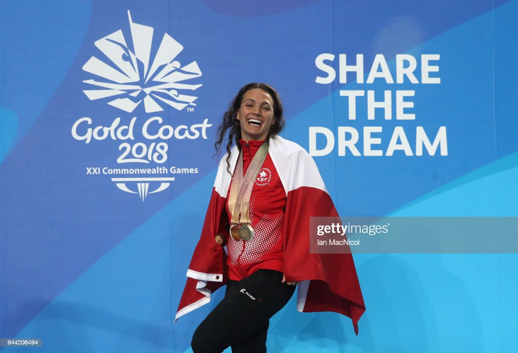 Kylie Masse of Canada poses with the four medals she won in the pool on day six of the Gold Coast 2018 Commonwealth Games at Optus Aquatic Centre on April 10, 2018 on the Gold Coast, Australia.