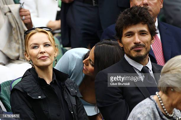 Kylie Minogue and Andres Velencoso watch on from the Royal Box on Centre Court on day eleven of the Wimbledon Lawn Tennis Championships at the All...