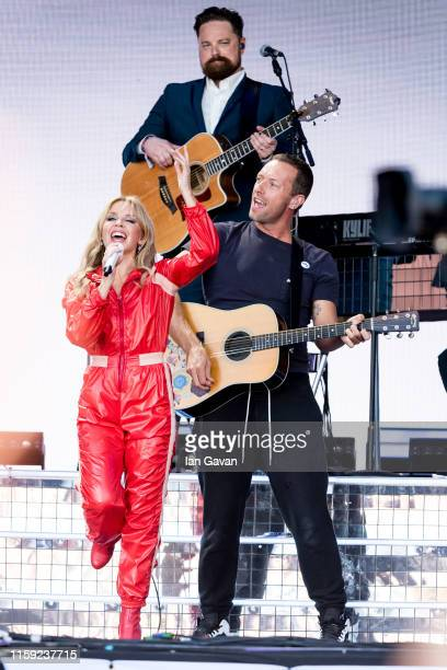 Kylie Minogue and Chris Martin of Coldplay perform on the Pyramid stage on day five of Glastonbury Festival at Worthy Farm, Pilton on June 30, 2019...