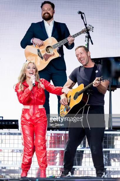 Kylie Minogue and Chris Martin of Coldplay perform on the Pyramid stage on day five of Glastonbury Festival at Worthy Farm Pilton on June 30 2019 in...