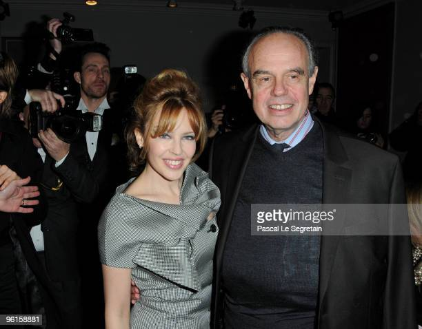 Kylie Minogue and Frederic Mitterand the French Minister of Culture and Communication attends the Christian Dior HauteCouture show as part of the...