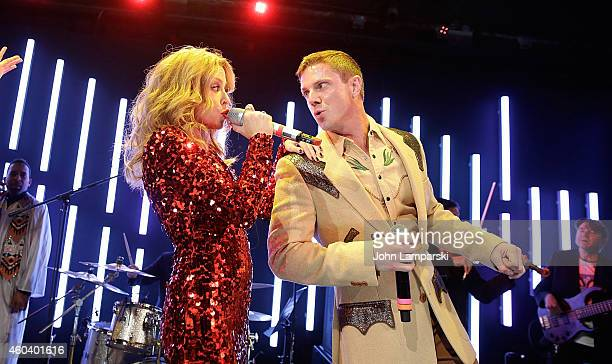 Kylie Minogue and Jake Shears of the Scissor Sisters perform at the A Dolly Good Xmas at Cedar Lake on December 12 2014 in New York City