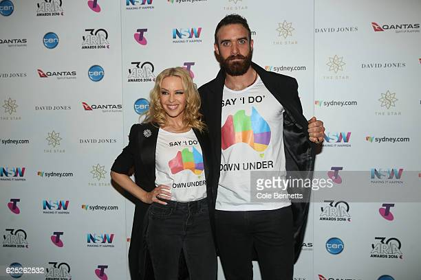 Kylie Minogue and Joshua Sasse pose in the ARIA awards room during the 30th Annual ARIA Awards 2016 at The Star on November 23 2016 in Sydney...