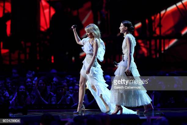 Kylie Minogue and Millie Bobby Brown present an award at The BRIT Awards 2018 held at The O2 Arena on February 21 2018 in London England