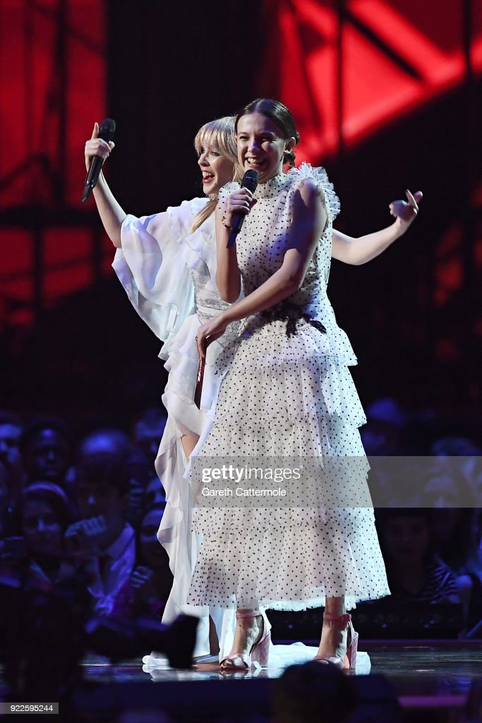 Kylie Minogue and Millie Bobby Brown present an award at The BRIT Awards 2018 held at The O2 Arena on February 21, 2018 in London, England.