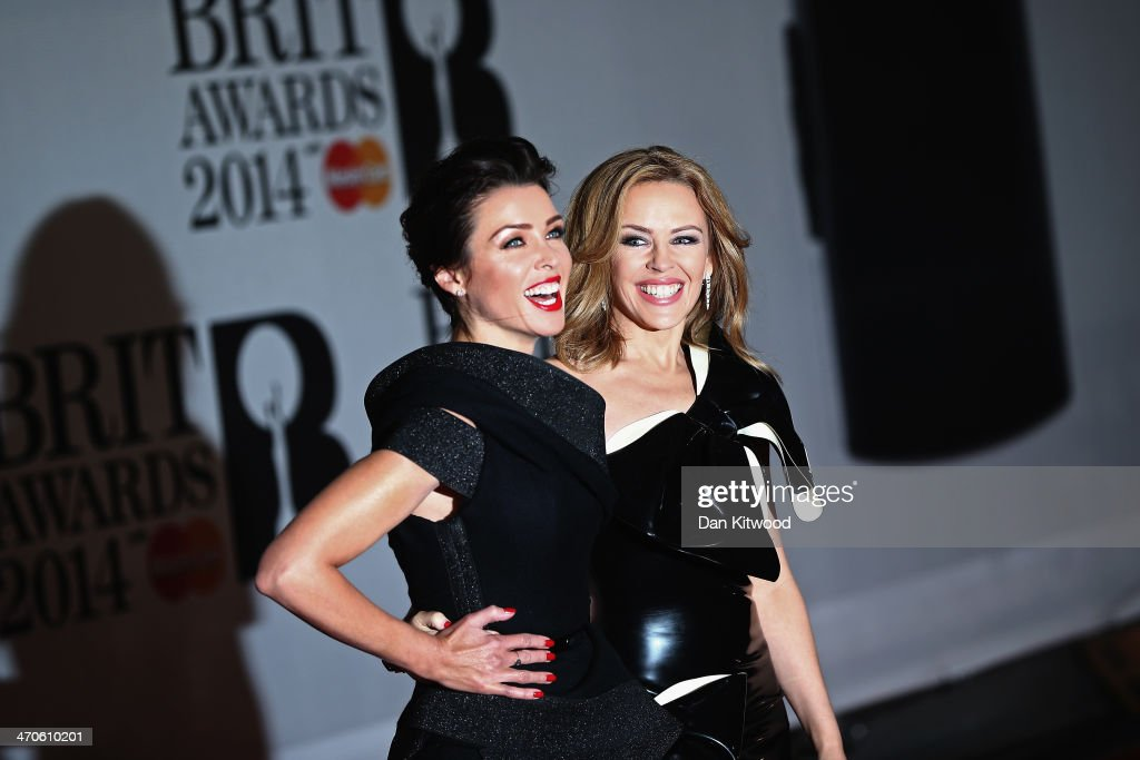 Kylie Minogue and sister Dani Minogue attends The BRIT Awards 2014 at 02 Arena on February 19, 2014 in London, England.