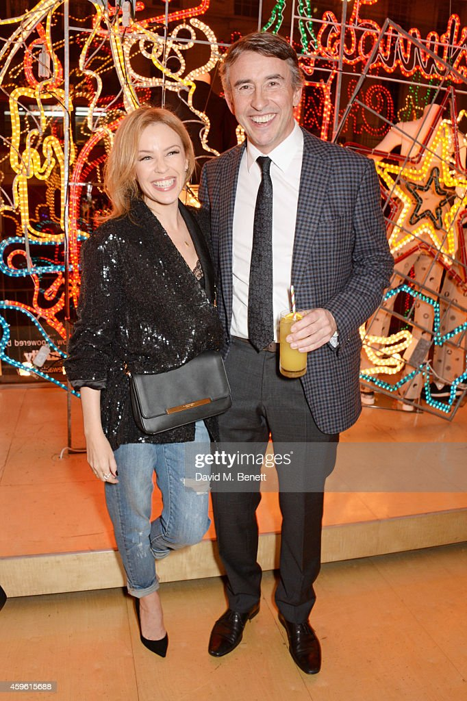 Kylie Minogue (L) and Steve Coogan attend the Stella McCartney Christmas Lights Switch On at the Stella McCartney Bruton Street Store on November 26, 2014 in London, England.