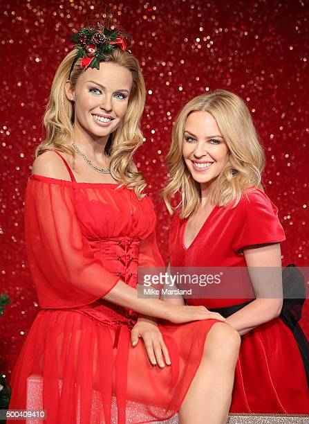 Kylie Minogue attends the unveiling of her wax figure in a special seasonal set at Madame Tussauds on December 8 2015 in London England