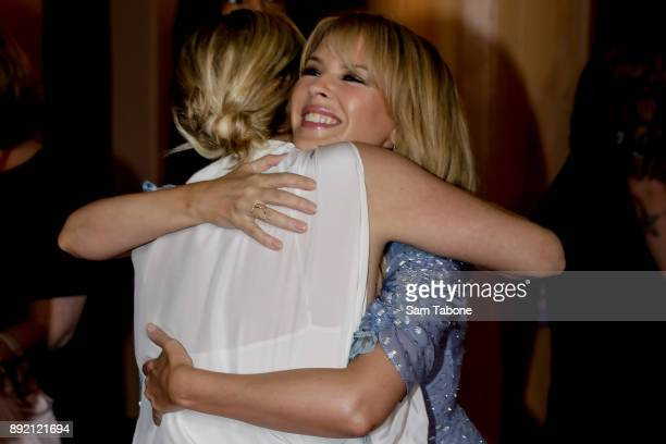 Kylie Minogue hugs Asher Keddy at the Melbourne premiere of Swinging Safari on December 14 2017 in Melbourne Australia