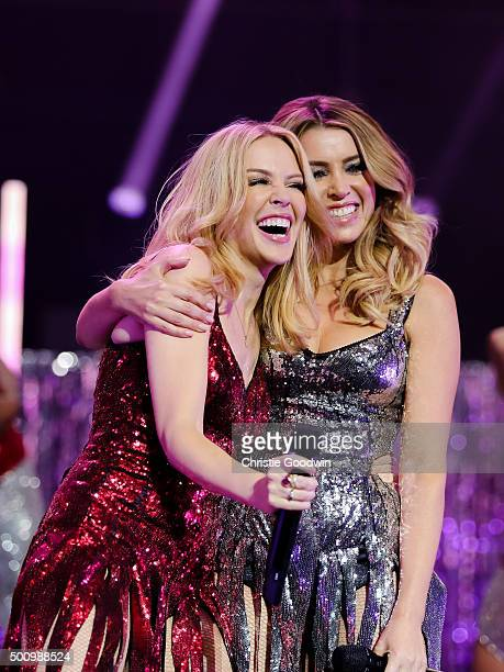 Kylie Minogue is joined by Dannii Minogue on stage during her Christmas show at the Royal Albert Hall on December 11 2015 in London England