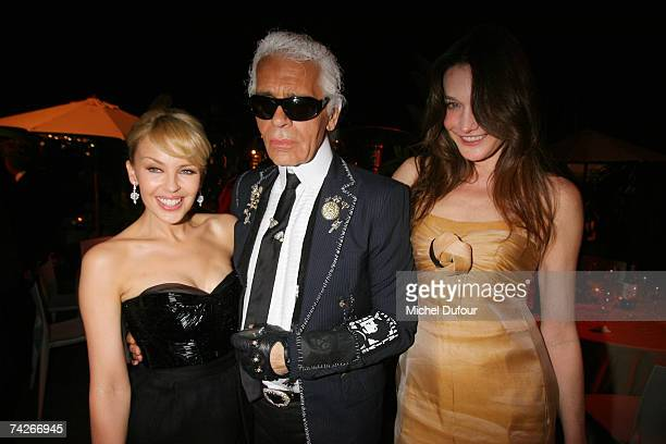 Kylie Minogue Karl Lagerfeld and Carla Bruni attend a dinner sponsored by magazine Madame Figaro to celebrate the Sixtieth Anniversary of the IFF on...