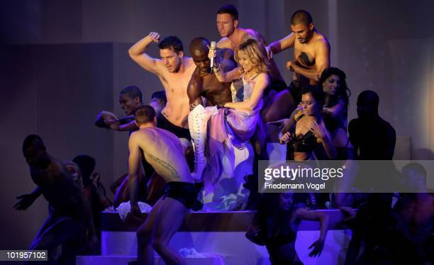 Kylie Minogue performs during the PRO7 TV show 'Germany's Next Topmodel Final' at the Lanxess Arena on June 10 2010 in Cologne Germany