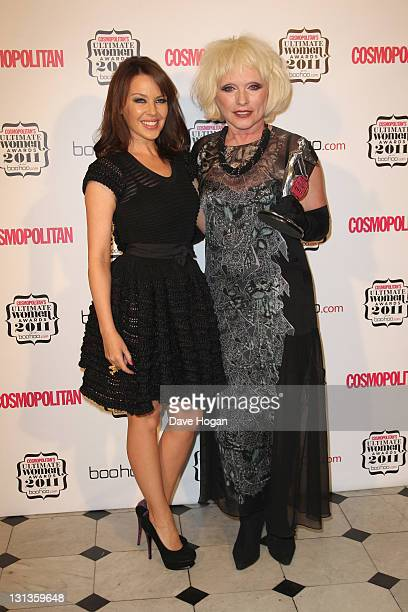Kylie Minogue poses with Debbie Harry in the press room at the Cosmopolitan Ultimate Women Of The Year Awards 2011 held at Banqueting House on...
