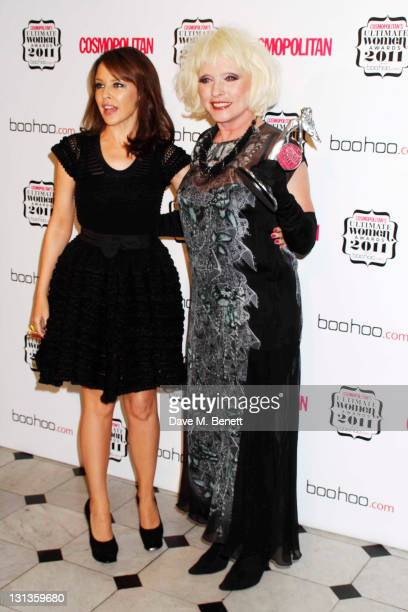 Kylie Minogue poses with Debbie Harry in the press room at the Cosmopolitan Ultimate Women Of The Year Awards 2011 at the Banqueting House on...