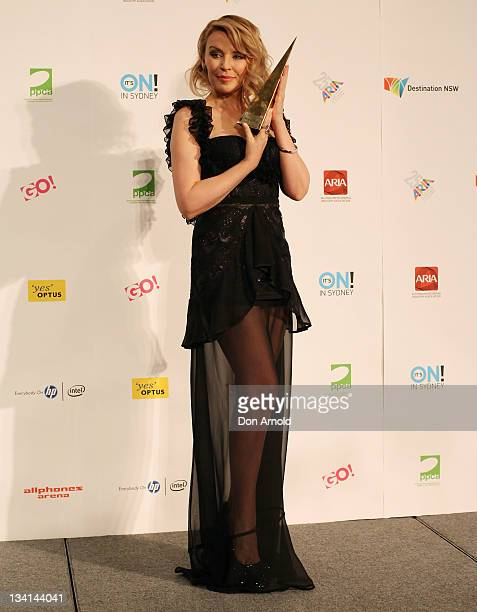 Kylie Minogue poses with her award after being inducted into the Aria Hall of Fame at the 2011 ARIA Awards at Allphones Arena on November 27 2011 in...