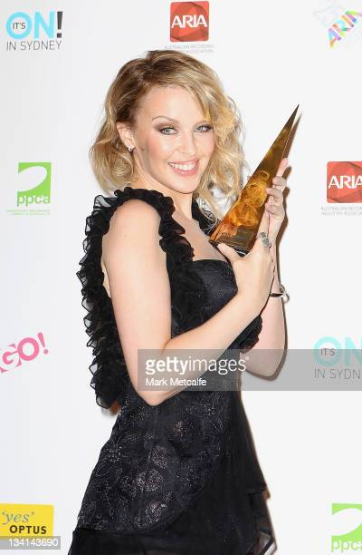 Kylie Minogue poses with her award for induction into the ARIA Hall of Fame at the 2011 ARIA Awards at Allphones Arena on November 27 2011 in Sydney...