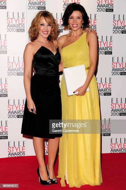 Kylie Minogue poses with sister Dannii Minogue and her TV Star award at the The ELLE Style Awards 2010 at the Grand Connaught Rooms on February 22...