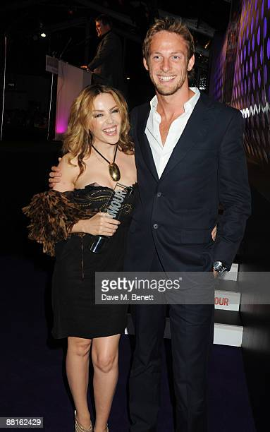 Kylie Minogue poses with the Woman of the Year Award presented by Jenson Button during the Glamour Women of the Year Awards 2009 at Berkeley Square...