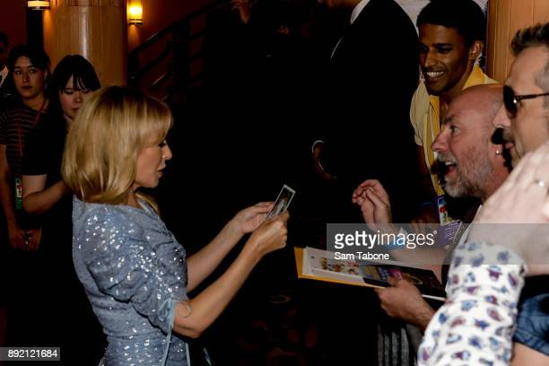 Kylie Minogue signing for fans at the Melbourne premiere of Swinging Safari on December 14 2017 in Melbourne Australia