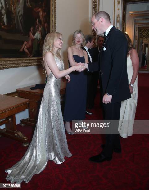 Kylie Minogue speaks with Prince William Duke of Cambridge during a reception for the Royal Marsden NHS Foundation Trust at Buckingham Palace on June...