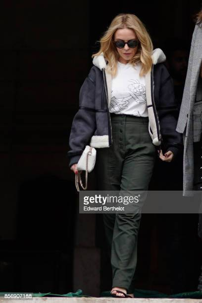 Kylie Minogue wears an aviator jacket green pants outside Stella Mccartney during Paris Fashion Week Womenswear Spring/Summer 2018 on October 2 2017...