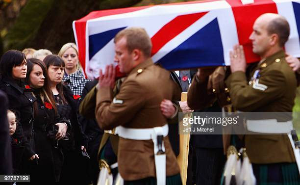 Kylie Moffat watches the coffin of her husband Corporal Thomas Mason carried into Douglas Bank Cemetery on November 5 2009 in Cowdenbeath in Scotland...