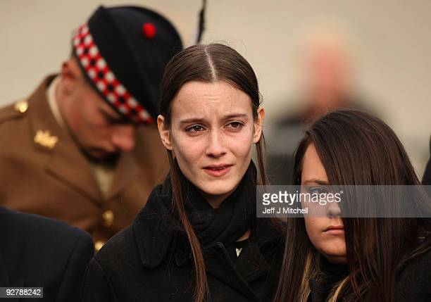 Kylie Moffat watches the coffin of her husband Corporal Thomas Mason carried from Trinity Parish Church on November 5 2009 in Cowdenbeath Scotland...