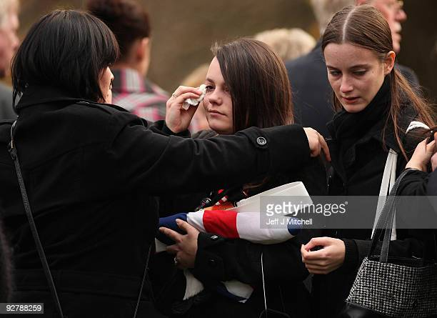 Kylie Moffat watches the coffin of her husband Corporal Thomas Mason carried into Douglas Bank Cemetery on November 5 2009 in Cowdenbeath Scotland...
