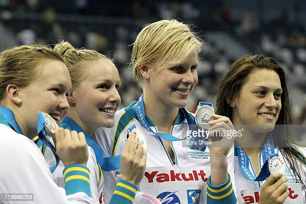 Kylie Palmer Bronte Barratt Angie Bainbridge and Blair Evans of Australia pose with the silver medal after the Women's 4x200m Freestyle final during...