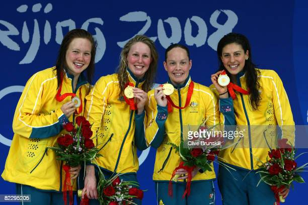 Kylie Palmer Bronte Barratt Linda Mackenzie and Stephanie Rice of Australia poses with the gold medal during the medal ceremony for the Women's 4 x...
