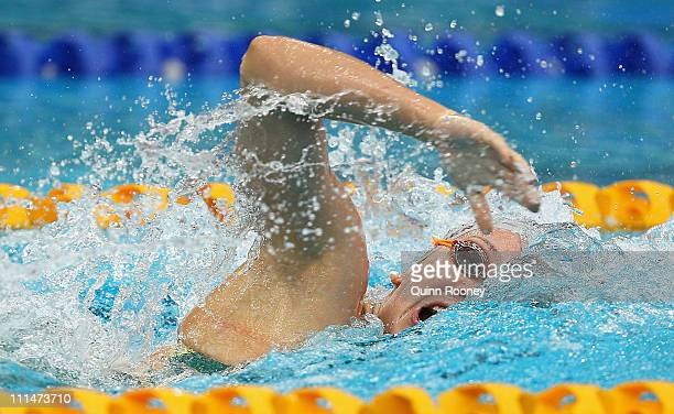 Kylie Palmer of Australia races in the Heats of the Women's 200 Metre Freestyle during day three of the 2011 Australian Swimming Championships at...